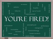 You're Fired Word Cloud Concept On A Blackboard