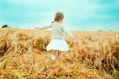 stock photo of little boys only  - dancing child nostalgic in field - JPG
