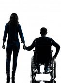 stock photo of handicap  - one handicapped man and woman holding hands in silhouette studio  on white background - JPG