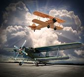 stock photo of biplane  - Retro style picture of the biplanes - JPG