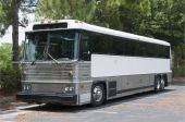 picture of motor coach  - Retired tour bus with tinted windows waiting to be sold - JPG