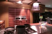 picture of dutch oven  - metallic dishes on the gas-fire in interior of the modern kitchen ** Note: Shallow depth of field - JPG