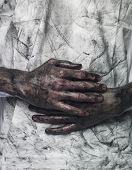 stock photo of doughy  - Very dirty hands in front of a dirty shirt - JPG