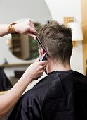 stock photo of barber razor  - Man at the hair salon - JPG