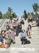 stock photo of segregation  - Large group of people sitting in the stairs - JPG