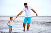 stock photo of swales  - father and son overcome obstacles together salted firth - JPG