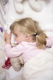 stock photo of goodnight  - Baby Girl in her bed - JPG