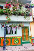 stock photo of medellin  - Colorful house with flowers in Guatape Antioquia in Colombia - JPG
