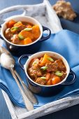 stock photo of stew pot  - beef stew with potato and carrot in blue pots - JPG