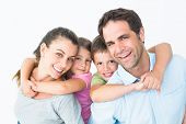 picture of pretty-boy  - Smiling young family looking at camera together on white background - JPG