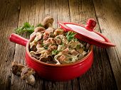 picture of edible mushroom  - tagliatelle with cep edible mushroom and bacon over casserole - JPG