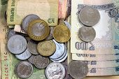 stock photo of indian currency  - closeup of Indian currency bank notes and coins - JPG