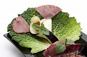 Fresh Cold Cuts from Pork with Savoy cabbage Sheets and Grapes