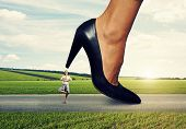 image of big-foot  - small calm woman under big female heel - JPG