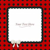 stock photo of asymmetric  - A cute black and red polka dot square frame accented with a small white bow and black lace - JPG