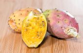 picture of prickly-pear  - Portion of fresh Prickly Pears on wooden background  - JPG