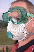 stock photo of osha  - safety goggles glasses respirator dust mask ppe - JPG