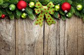 pic of fir  - Fir branch and Christmas balls on wooden background - JPG