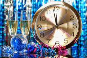 stock photo of midnight  - New year party decoration with champagne and clock close to midnight - JPG
