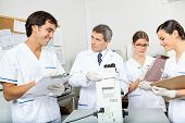 pic of scientist  - Group of scientists working together in medical laboratory - JPG