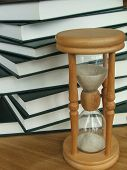 picture of time study  - a lot of books with an hourglass - JPG
