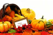 stock photo of wooden basket  - Harvest basket with spilling autumn vegetables and Happy Thanksgiving tag - JPG