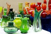 foto of flea  - colorful glass vases at the flea market - JPG