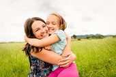 foto of mother-in-love  - Mother and child are hugging and having fun outdoor in nature - JPG