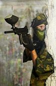 pic of paintball  - paintball sport player man in protective camouflage uniform and mask with marker gun outdoors - JPG
