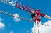 image of boom-truck  - A Construction crane against the blue sky - JPG