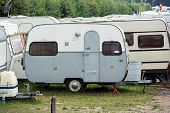 pic of caravan  - An outmoded travel trailer in a row of Old - JPG