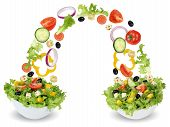 stock photo of cucumber  - Flying salad ingredients in bowl with tomatoes Feta cheese onion olives and cucumber - JPG