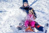 picture of sleigh ride  - Father and daughter on a sled ride - JPG
