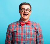 pic of nerd glasses  - funny nerd with glasses on blue background - JPG