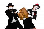 foto of struggle  - Two mimes as business man and woman fighting over briefcase isolated on white background - JPG