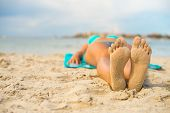foto of sunbather  - Woman sunbathing on sand - JPG