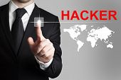 picture of incognito  - businessman in black suit pushing button hacker worldmap - JPG