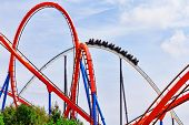 image of amusement  - Roller Coaster in funny amusement  park in summer day - JPG