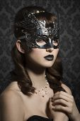 foto of mystery  - Attractive mysterious woman with silver carnival mask and very dark make up - JPG