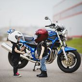 stock photo of motorcycle  - cute little bikers on road with motorcycle - JPG
