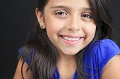 picture of sissy  - A Columbian Little Girl Fun Look in front of a black background - JPG