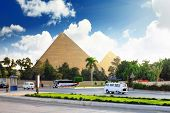 foto of the great pyramids  - Ancient Great Pyramids and present day of Giza townsuburb of Cairo city - JPG