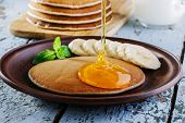 pic of dessert plate  - Pancake banana plate on a wooden surface - JPG