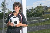 picture of 13 year old  - A soccer player holding a ball and smiling - JPG