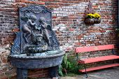 foto of cherub  - Cherub Fountain with pink bench and ferns - JPG