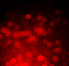 stock photo of february  - red defocused lights background - JPG