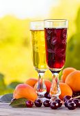 pic of apricot  - Sweet wine with apricots and cherries on wooden table - JPG