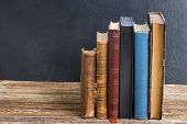 picture of vintage antique book  - Wooden bookshelf  with row of antique books - JPG