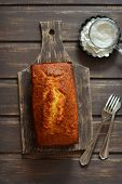picture of orange  - cake tangerine on a dark wooden surface - JPG