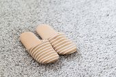 image of guest-house  - Pair of white slippers on a carpet - JPG
